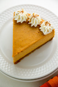 pumpkin-ricotta-cheesecake-with-brown-butter-crust-and-grand-marnier-whipped-cream