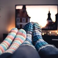 Couple,With,Socks,And,Woolen,Stockings,Watching,Movies,Or,Series