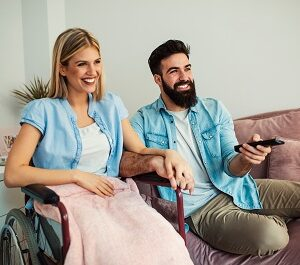 Handicapped,Woman,And,Her,Husband,Watching,Tv,Together