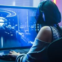 Shot,Of,The,Beautiful,Pro,Gamer,Girl,Playing,In,First-person